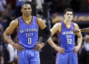 Photo - Oklahoma City's Russell Westbrook (0) reacts during Game 2 of the Western Conference Finals in the NBA playoffs between the Oklahoma City Thunder and the San Antonio Spurs at the AT&T Center in San Antonio, Wednesday, May 21, 2014. Photo by Sarah Phipps