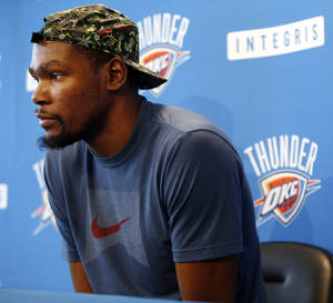 Photo - Kevin Durant listens to a question during exit interviews with the media for the Oklahoma City Thunder at the team's practice facility in Oklahoma City, Sunday, June 1, 2014. The Photo by Nate Billings, The Oklahoman