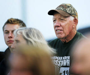 Photo - Former OU assistant coach Bobby Proctor watches his grandson Beau Proctor of Norman North play during a high school football game between Edmond North and Norman North in Norman, Okla., Thursday, Oct. 11, 2012. Photo by Nate Billings, The Oklahoman