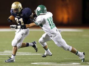 photo - Kingfisher's Landon Nault looks to get past Seminole's Kaden Wilson during the high school playoff game between Seminole and Kingfisher at Putnam City High School,  Saturday,Dec. 1, 2012. Photo by Sarah Phipps, The Oklahoman