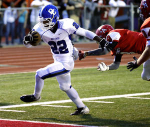 Photo - Deer Creek's Marcus Coleman scores in the first quarter during a high school football game between the Carl Albert Titans and the Deer Creek Antlers on Friday, Sept. 27, 2013 in Midwest City, Okla. Photo by Steve Sisney, The Oklahoman