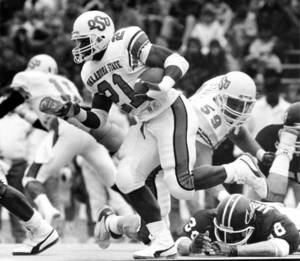 Photo -  Oklahoma State University running back Barry Sanders breaks free for a first down during the OSU-Kansas State on October 29, 1988 in Manhattan, KS. Photo by Jim Argo taken 10/29/88.