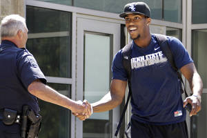 Photo - Penn State University football wide receiver Justin Brown, right, leaves the Lasch Football building after a team meetings explaining the ramifications of the NCAA sanctions against the Penn State University football program in State College, Pa.,  Monday, July 23, 2012.  (AP Photo/Gene J. Puskar) ORG XMIT: PAGP127
