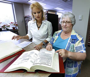 Photo - Cleveland County Clerk Tammy Belinson, left, and Deputy Clerk Jan Skelton look through county records on Friday, May 31, 2013 in Norman, Okla.  Photo by Steve Sisney, The Oklahoman