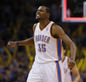 Photo - Oklahoma City's Kevin Durant (35) celebrates during an NBA basketball game between the Oklahoma City Thunder and the Golden State Warriors at Chesapeake Energy Arena in Oklahoma City, Friday, Jan. 17, 2014. Oklahoma City won 127-121. Photo by Bryan Terry, The Oklahoman