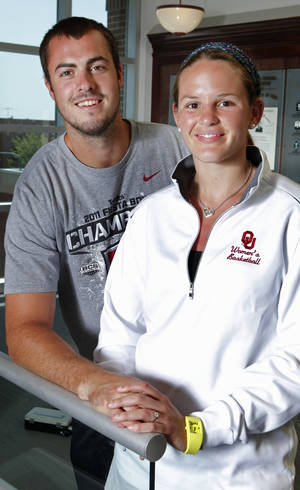 Photo - OU quarterback Landry Jones, left, and basketball standout Whitney Hand were recently married. While Jones is in Norman getting ready for the football season, Hand is on a basketball tour in Australia. Photo by Steve Sisney, The Oklahoman Archives