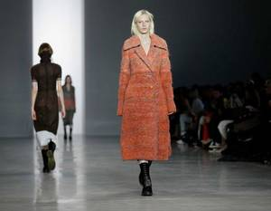 Photo - STATEMENT COATS. Plush outerwear seemed fitting on the runway during a cold, snowy fashion week in New York. This coat was from the Calvin Klein fashion show. AP PHOTO <strong></strong>