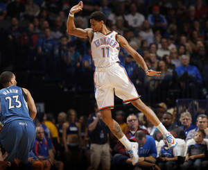 Photo -  Oklahoma City's Jeremy Lamb (11) tries to block the shot of Minnesota's Kevin Martin (23) during the NBA game between the Oklahoma City Thunder and the Minnesota Timberwolves at the Chesapeake Energy Arena, Sunday, Dec. 1, 2013. Photo by Sarah Phipps, The Oklahoman