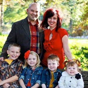 Photo - James Hunt, pastor of blended families and the Karis adoption, foster and orphan care ministry at Council Roads Baptist Church in Bethany, is shown with his family, wife Ali and their four children who are adopted. Photo provided <strong></strong>