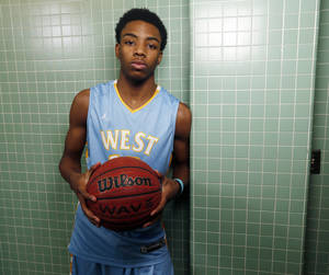 Photo - Putnam City West basketball player Tyson Jolly poses for a photo at PC West High School in Oklahoma City, Wednesday, Feb. 26, 2014. Jolly collapsed in this hallway at the high school before finding out he had a pulmonary embolism and multiple blood clots in his lungs. Photo by Nate Billings, The Oklahoman