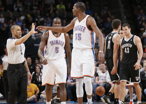 Photo - Oklahoma City's Kevin Durant (35) yells at the official before being thrown out of the game during the NBA basketball game between the Oklahoma City Thunder and the Brooklyn Nets at the Chesapeake Energy Arena on Wednesday, Jan. 2, 2013, in Oklahoma City, Okla. Photo by Chris Landsberger, The Oklahoman