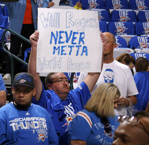 Photo - Bob Bandy of Moore holds a sign before  Game 1 in the second round of the NBA playoffs between the Oklahoma City Thunder and L.A. Lakers at Chesapeake Energy Arena in Oklahoma City, Monday, May 14, 2012. Photo by Bryan Terry, The Oklahoman