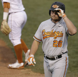 Photo - OSU's Zach Fish reacts after getting out in the fourth inning of a Big 12 Tournament baseball game between Oklahoma State University and the University of Texas at Chickasaw Bricktown Ballpark in Oklahoma City, Thursday, May 22, 2014. Photo by Bryan Terry The Oklahoman