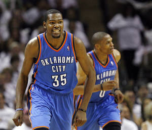 Photo - Oklahoma City's Kevin Durant (35) smiles in front of Russell Westbrook (0) after hitting a shot in the third quarter during Game 5 of the Western Conference Finals between the Oklahoma City Thunder and the San Antonio Spurs in the NBA basketball playoffs at the AT&T Center in San Antonio, Monday, June 4, 2012. The Thunder won, 108-103. Photo by Nate Billings, The Oklahoman