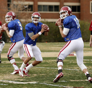 Photo - OU quarterbacks, from left, Trevor Knight, Kendal Thompson and Blake Bell are all competing to become the stater when the 2013 season starts. Bell might have an advantage, though, because of his game experience.  Photo by Steve Sisney, The Oklahoman