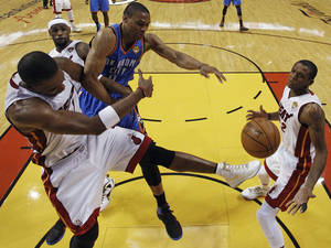 photo - Miami Heat power forward Chris Bosh, left, Oklahoma City Thunder small forward Kevin Durant (35) and small forward LeBron James (6) lose the rebound as Miami Heat small forward James Jones (22) looks on during the first half at Game 3 of the NBA Finals basketball series, Sunday, June 17, 2012, in Miami. (AP Photo/Lynne Sladky, Pool) ORG XMIT: NBA121
