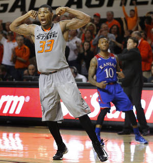 Photo - Oklahoma State's Marcus Smart (33) celebrates in front of Kansas' Naadir Tharpe (10) during an NCAA college basketball game between Oklahoma State University (OSU) and the University of Kansas at Gallagher-Iba Arena in Stillwater, Okla., Saturday, March 1, 2014. Oklahoma State won 72-65. Photo by Bryan Terry, The Oklahoman