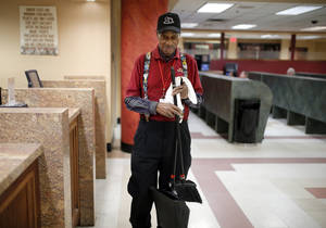 Photo - Delmar Hopkins, 105, works at Remington Park in Oklahoma City,  Thursday, Nov. 14, 2013. Photo by Sarah Phipps, The Oklahoman