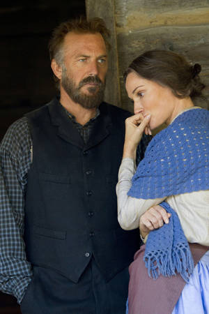 "Photo - Kevin Costner and Sarah Parish as Devil Anse and Levicy Hatfield in the miniseries""Hatfields & McCoys"" HISTORY PHOTO <strong>Chris Large</strong>"