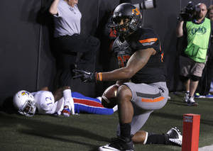 Photo - Oklahoma State's Tracy Moore (87) celebrates his touchdown pass in front of KU's Dexter McDonald (12) during a college football game between the Oklahoma State University Cowboys (OSU) and the University of Kansas Jayhawks (KU) at Boone Pickens Stadium in Stillwater, Okla., Saturday, Nov. 9, 2013. Photo by Sarah Phipps, The Oklahoman
