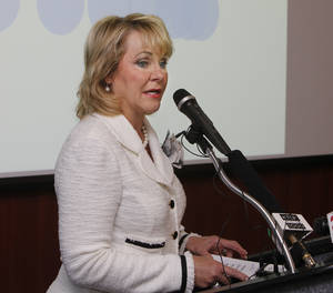 Photo - Governor Mary Fallin discusses a new series of jobs being offered by AT&T, during a press conference at the Oklahoma City  Chamber of Commerce in Oklahoma City, OK, Thursday, June 27, 2013,  Photo by Paul Hellstern, The Oklahoman