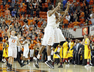 photo - Oklahoma State's Phil Forte (13), Michael Cobbins (20) and Markel Brown (22) react in the final seconds of the win over Iowa State during the college basketball game between the Oklahoma State University Cowboys (OSU) and the Iowa State University Cyclones (ISU) at Gallagher-Iba Arena on Wednesday, Jan. 30, 2013, in Stillwater, Okla.  Photo by Chris Landsberger, The Oklahoman