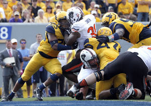 Photo - Oklahoma State's Jeremy Smith (31) is stuffed from the end zone during the second half of a college football game between the Oklahoma State University and West Virginia University on Mountaineer Field at Milan Puskar Stadium in Morgantown, W. Va.,   Saturday, Sept. 28, 2013. Photo by Sarah Phipps, The Oklahoman