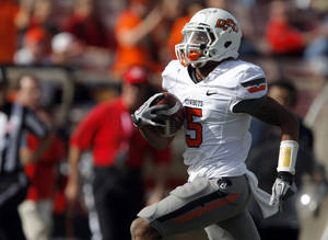 Photo - Oklahoma State's Josh Stewart (5) runs in for a score during a college  football game between Texas Tech University (TTU) and Oklahoma State University (OSU) at Jones AT&T Stadium in Lubbock, Texas, Saturday, Nov. 12, 2011.  Photo by Sarah Phipps, The Oklahoman ORG XMIT: KOD
