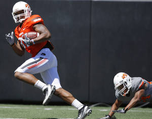 Photo - OKLAHOMA STATE UNIVERSITY / OSU / COLLEGE FOOTBALL: OSU's Tracy Moore runs for a touchdown after catching the ball in front of Miketavius Jones during Oklahoma State's spring football game at Boone Pickens Stadium in Stillwater, Okla., Saturday, April 21, 2012. Photo by Bryan Terry, The Oklahoman