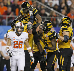 Photo - Missouri celebrates a touchdown by Henry Josey (20) in the first quarter near Oklahoma State's Tyler Patmon (26) during the AT&T Cotton Bowl Classic college football game between the Oklahoma State University Cowboys (OSU) and the University of Missouri Tigers at AT&T Stadium in Arlington, Texas, Friday, Jan. 3, 2014. Photo by Nate Billings, The Oklahoman