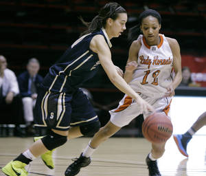 photo - Booker T. Washington Hornets No.12 Kaylan Mayberry guards Southmoore Lady Sabercats No.21 Kayla Tucker during the class 6A state tournament girls quarterfinal basketball game in Skiatook, Okla., taken on March 7,2013. JAMES GIBBARD/Tulsa World