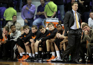 photo - Oklahoma State coach Travis Ford and his bench watch the final moments of an NCAA college basketball game against Kansas State, Saturday, Jan. 5, 2013, in Manhattan, Kan. Kansas State won 73-67. (AP Photo/Charlie Riedel) ORG XMIT: KSCR113