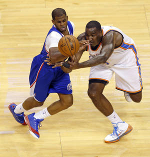 Photo - Los Angeles' Chris Paul (3) and Oklahoma City's Kendrick Perkins (5) try to control the ball during Game 1 of the Western Conference semifinals in the NBA playoffs between the Oklahoma City Thunder and the Los Angeles Clippers at Chesapeake Energy Arena in Oklahoma City, Monday, May 5, 2014. Photo by Bryan Terry, The Oklahoman
