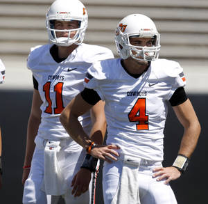 photo - OSU&#039;s Wes Lunt, left, and J.W. Walsh stand stand beside each other before Oklahoma State&#039;s spring football game at Boone Pickens Stadium in Stillwater, Okla., Saturday, April 21, 2012. Photo by Bryan Terry, The Oklahoman