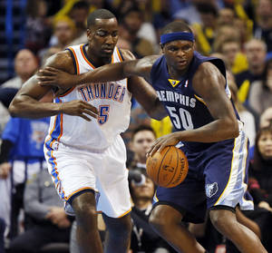 Photo - Memphis' Zach Randolph (50) works against Oklahoma City's Kendrick Perkins (5) during an NBA basketball game between the Oklahoma City Thunder and the Memphis Grizzlies at Chesapeake Energy Arena in Oklahoma City, Monday, Feb. 3, 2014. Photo by Nate Billings, The Oklahoman