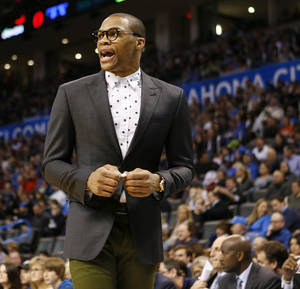 Photo - Oklahoma City's Russell Westbrook (0) encourages his team from the bench area during an NBA basketball game between the New York Knicks and the Oklahoma City Thunder at Chesapeake Energy Arena in Oklahoma City, Sunday, Feb. 9, 2014. Photo by Nate Billings, The Oklahoman