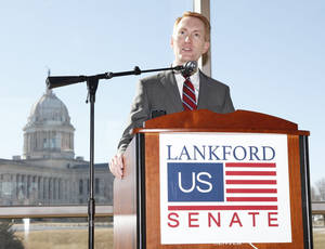 Photo - U.S. Rep. James Lankford announces his run for the Senate seat being vacated by Sen. Tom Coburn on Monday during a news conference at the Oklahoma History Center in Oklahoma City. Photo by Paul Hellstern, The Oklahoman