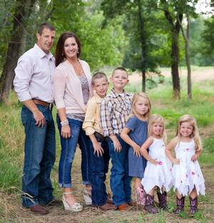 Photo - In this Aug. 19 photo, Rep. Markwayne Mullin and his wife, Christie, pose with their children, from left, Jim, Andrew, Larra, Ivy and Lynette. The Mullins' adoption of Ivy and Lynette was finalized Aug. 21. PHOTO PROVIDED <strong>Mallory Hall</strong>
