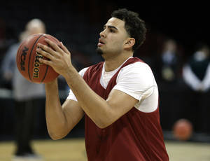 Photo - Oklahoma's Frank Booker (1) shoots baskets during practice for the NCAA men's basketball tournament at the Spokane Arena in Spokane, Wash., Wednesday, March 19, 2014.Photo by Sarah Phipps, The Oklahoman