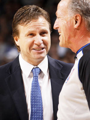 photo - NBA BASKETBALL: Oklahoma CIty coach Scott Brooks talks with an official during a preseason NBA game between the Oklahoma City Thunder and the Dallas Mavericks at Chesapeake Energy Arena in Oklahoma City, Tuesday, Dec. 20, 2011. Photo by Bryan Terry, The Oklahoman
