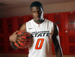 Photo - COLLEGE BASKETBALL: OSU men's basketball player Jean-Paul Olukemi (0) poses for a portrait at Oklahoma State University in Stillwater, Okla., Thursday, Oct. 27, 2011.  Photo by Nate Billings, The Oklahoman