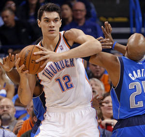 Photo - The play of Steven Adams, left, has been a big surprise for the Thunder so far.  Photo by Chris Landsberger, The Oklahoman
