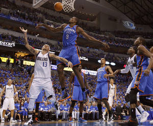 Photo - Oklahoma City's Serge Ibaka (9) defends Dallas' Delonte West (13). during Game 3 of the first round in the NBA playoffs between the Oklahoma City Thunder and the Dallas Mavericks at American Airlines Center in Dallas, Thursday, May 3, 2012. Photo by Bryan Terry, The Oklahoman