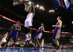 photo - Oklahoma City's' Kendrick Perkins (5) dunks the ball during the NBA game between the Oklahoma City Thunder and the Phoenix Suns at theChesapeake Energy Arena, Saturday, Feb. 9, 2013.Photo by Sarah Phipps, The Oklahoman