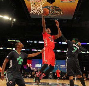 Photo - West Team's Kevin Durant, of the Oklahoma City Thunder (35) heads to the hoop against =Team East during the NBA All Star basketball game, Sunday, Feb. 16, 2014, in New Orleans. (AP Photo/Bob Donnan, Pool)