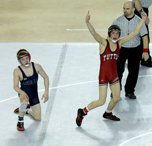 Photo - Tuttle's Blake Dauphin, at right, celebrates after beating Scout Skidgel of Cascia Hall in the Class 4A 113-pound championship match during the state wrestling championships at the State Fair Arena in Oklahoma City, Saturday, Feb. 23, 2013. Photo by Bryan Terry, The Oklahoman