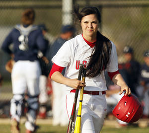 Photo - HIGH SCHOOL BASEBALL: U.S. Grant baseball player Judith Alvarado brings her helmet and a pair of bats back to the dugout after the inning ended while she was on deck in a game against Ponca City at U.S. Grant High School in Oklahoma City, Monday, April 22, 2013. Photo by Nate Billings, The Oklahoman
