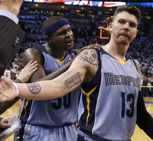 Photo -                    The Thunder might target Memphis shooter Mike Miller, right, with the team's mid-level exception.                     AP photo