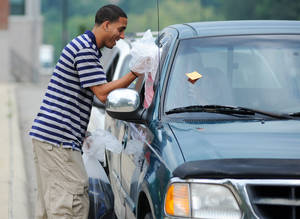 photo - Kevin Martin helps distribute backpacks in his hometown of Zanesville, Ohio in this August 2012 file photo. Eastside Community Ministry hosted its annual Tools for Schools giveaway, passing out 753 backpacks stuffed with school supplies. Photo courtesy Zanesville Times Recorder.