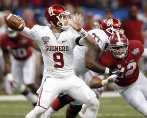 Photo - Oklahoma's Trevor Knight (9) passes the ball during the NCAA football BCS Sugar Bowl game between the University of Oklahoma Sooners (OU) and the University of Alabama Crimson Tide (UA) at the Superdome in New Orleans, La., Thursday, Jan. 2, 2014.  Photo by Chris Landsberger, The Oklahoman